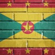 Grenada flag on brick wall — Stock Photo