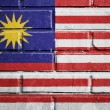 Malaysia flag on brick wall — Stock Photo