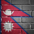 Nepal flag on a textured brick wall — Stock Photo