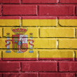 Spain flag on a textured brick wall — Stock Photo