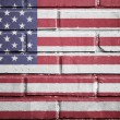 Stock Photo: United states flag on brick wall