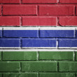 Stock Photo: Gambia flag on a textured brick wall