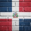 Dominican republic flag on brick wall — Stock Photo