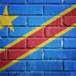 Democratic republic of the Congo flag on a textured brick wall — Stock Photo