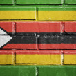 Zimbabwe flag on brick wall — Stock Photo