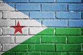 Djibouti flag on a textured brick wall — Stock Photo