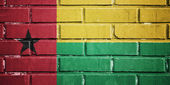 Guinea bissau flag on brick wall — Stock Photo