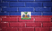 Haiti flagge auf ziegelmauer — Stockfoto