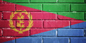 Eritrea flag on brick wall — Stock Photo