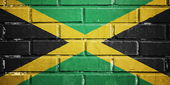Jamaica flag on brick wall — Stock Photo
