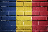 Romania flag on a textured brick wall — Stock Photo