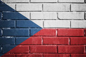 Czech Republic flag on a textured brick wall — Stock Photo