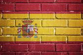 Spain flag on a textured brick wall — Stock Photo