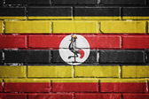 Uganda flag on a textured brick wall — Stock Photo