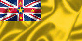 Niue flag blowing in the wind — Stock Photo
