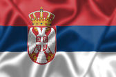 Serbia flag blowing in the wind — Stock Photo