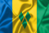 Saint Vincent and the Grenadines flag blowing in the wind — Stock Photo