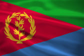 Eritrea flag blowing in the wind — Stock Photo