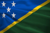 Solomon Islands flag blowing in the wind — Stock Photo