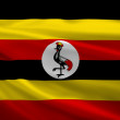 Uganda flag blowing in the wind — Stock Photo