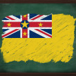 Niue flag painted with chalk on blackboard — Stock Photo