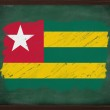 Togo flag painted with chalk on blackboard — Stock Photo #34611237