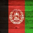 Afghanistan Flag painted on old wood plank background. — Stockfoto