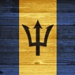 Barbados Flag painted on old wood plank background. — Stock Photo #35209699