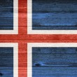 Iceland Flag painted on old wood plank background. — Stock Photo