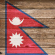 Nepal Flag painted on old wood plank background. — Stock Photo