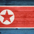 North Korea Flag painted on old wood plank background. — Stock Photo