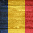 Romania Flag painted on old wood plank background. — Stock Photo #35212487