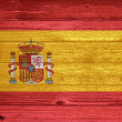 Spain Flag painted on old wood plank background. — Stock Photo