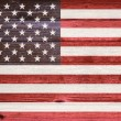 United States Flag painted on old wood plank background. — Stock Photo