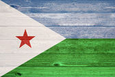 Djibouti Flag painted on old wood plank background. — Foto Stock