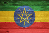 Ethiopia Flag painted on old wood plank background. — Foto Stock