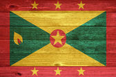 Grenada Flag painted on old wood plank background. — Foto Stock