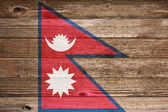 Nepal Flag painted on old wood plank background. — Foto Stock