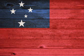 Samoa Flag painted on old wood plank background. — Foto Stock