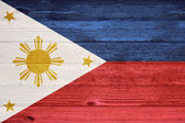 The Philippines Flag painted on old wood plank background. — Foto Stock
