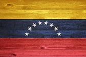 Venezuela Flag painted on old wood plank background. — Foto Stock