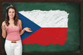 Beautiful and smiling woman showing flag of Czech republic on bl — Stock Photo