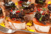 Inky Calamari Crostini. Unsharpened file — Stock Photo