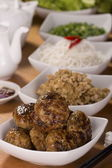 Cambodian Banchao. Grilled Pork Patties typically served with vegetables, rice vermicelli, condiments, fish sauce and sometimes a broth — Stock Photo