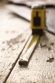 Old Tape Measure and Hand Saw on Weathered Wood with shallow DOF — Stock Photo