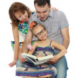 The family reads — Stock Photo