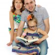 The family reads the book — Stock Photo