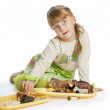 Nice little girl playing with — Stock Photo