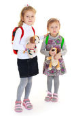 Girls sisters with toys — Stock Photo