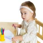 Little girl draws — Stock Photo